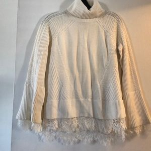 Winter white turtleneck sweater with lace details